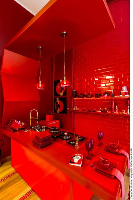 All red kitchen with subway tiles