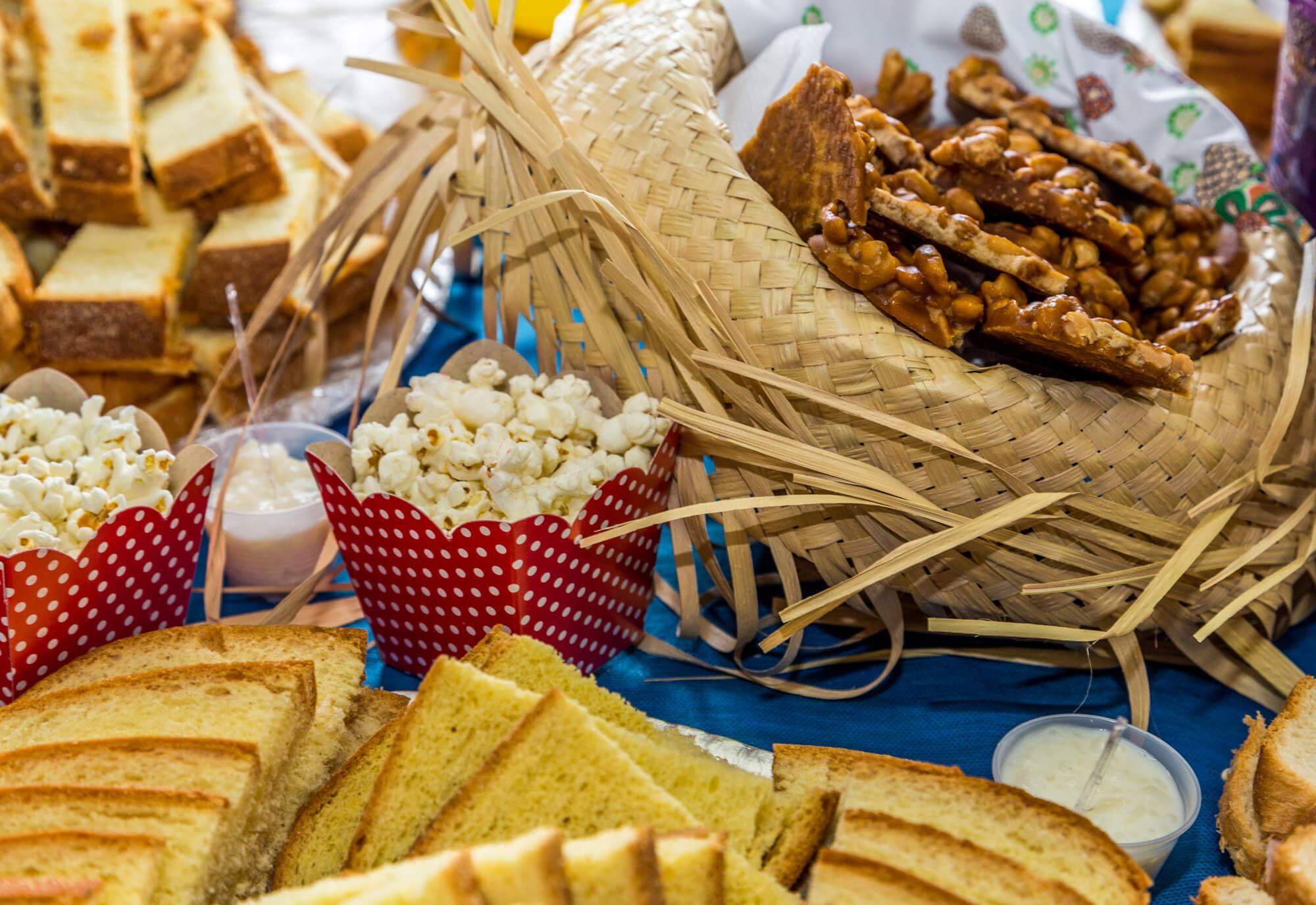junina party decorations on a table decorated with typical foods