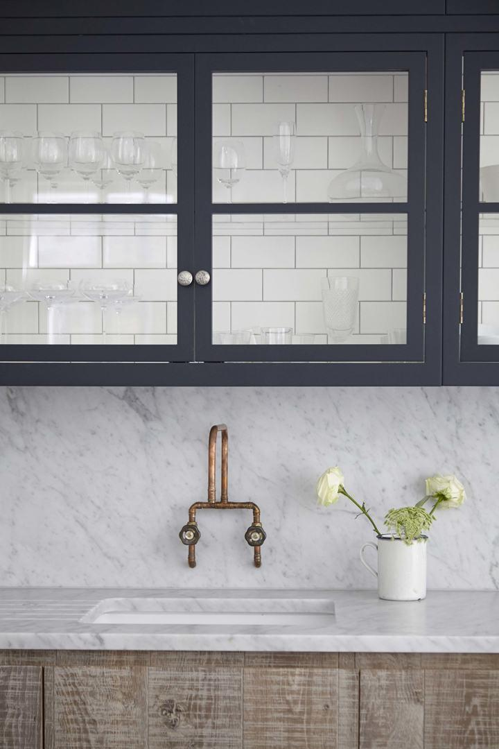 Subway tiles inside the kitchen cabinet