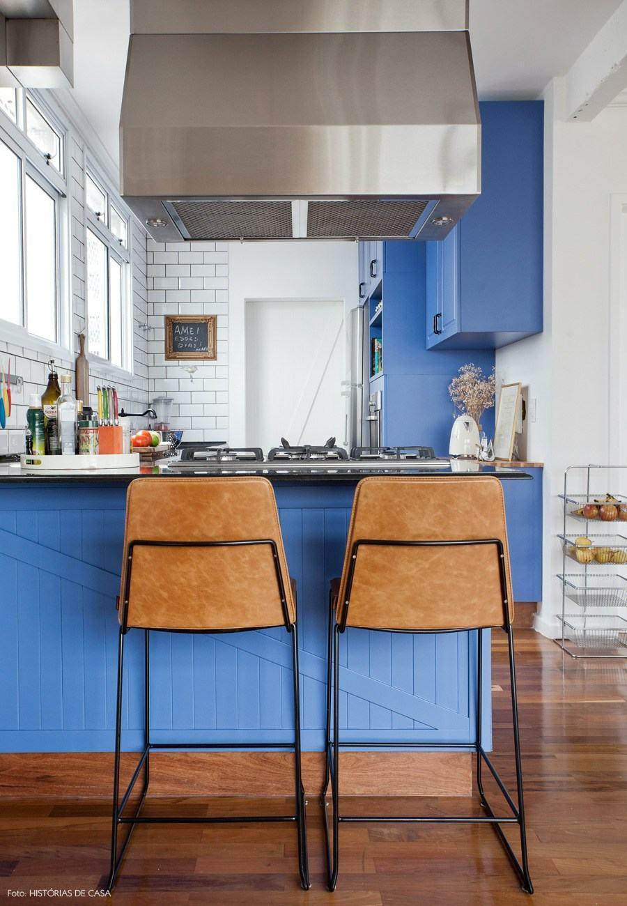 White wall and blue cabinets